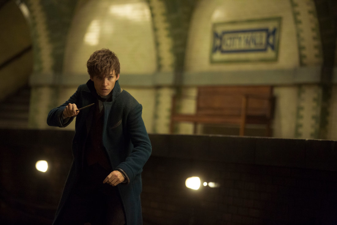 Newt with his wand drawn in New York's City Hall subway station.